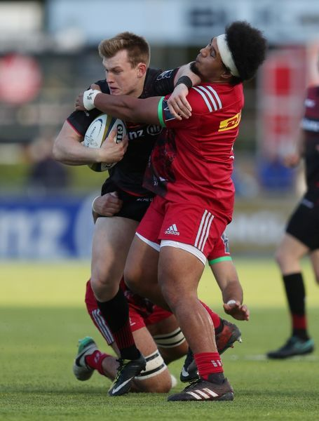 Saracens Nick Tompkins is tackled by Harlequins Elia Elia during the Anglo Welsh Cup match at Allianz Park, London
