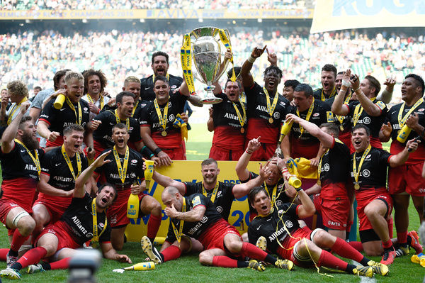Saracens players celebrate with the Aviva Premiership trophy after victory over Exeter Chiefs in the Aviva Premiership Final at Twickenham, London