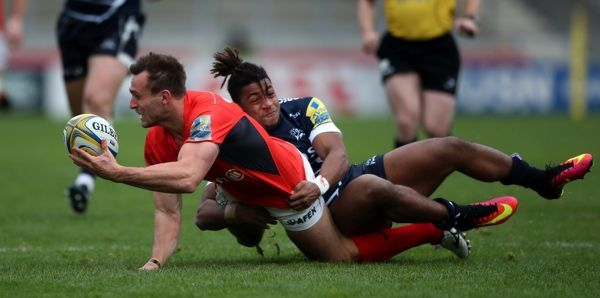 Sale Sharks's Paolo Odogwa is tackles Saracens' Andrew Fenby during the Aviva Premiership match at The AJ Bell Stadium, Sale