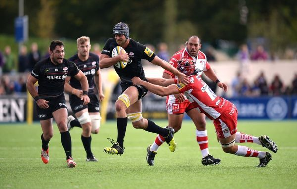 Saracens' Alistair Hargreaves gets away from Gloucester Rugby's Tom Palmer during the Aviva Premiership match at Allianz Park, London