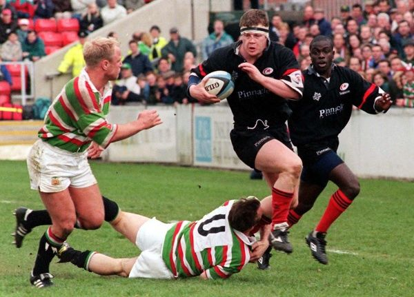 Saracens' Irish international prop Paul Wallace with Muna Ebongalame supporting breaks through Leicester's Bill Drake-Lee tackle as Neil Back (left) comes across to intercept during today's (Saturday) Courage league One match at Welford Road