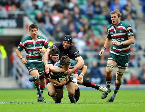Leicester Tigers' Anthony Allen (bottom) is tackled by Saracens' Andt Saull (centre) and Steve Borthwick (top) during the Guinness Premiership Final at Twickenham, London