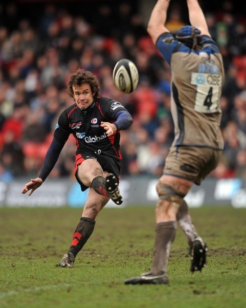 Saracens' Derick Hougaard kicks during the Guinness Premiership match at Vicarage Road, Watford