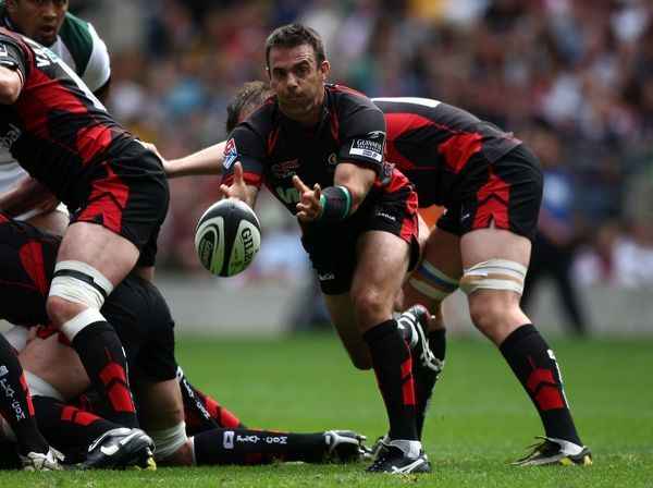 Saracens' scrum half Neil de Kock offloads the ball from the back of a ruck