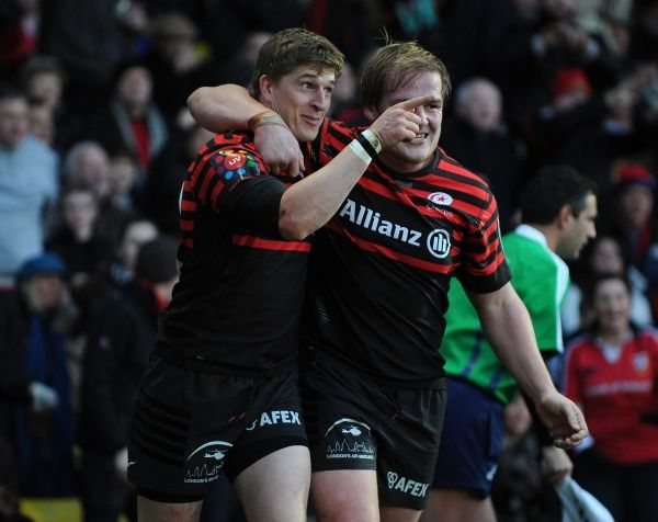 Saracens' David Strettle (left) celebrates scoring their first try