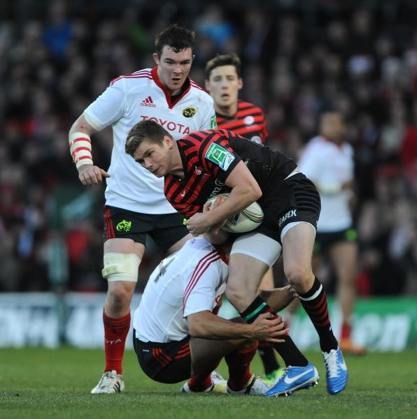 Saracens' Owen Farrell is tackled by Munsters' Doug Howlett during the Heineken Cup, Pool One match at Vicarage Road, London