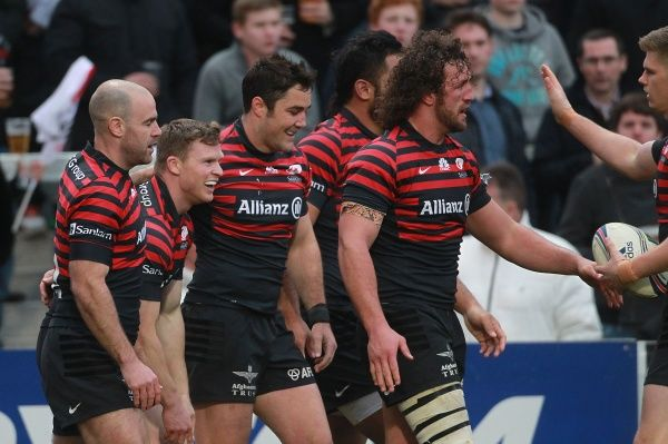 Saracens' Chris Ashton (second left) celebrates with team-mates after scoring a try during the Heineken Cup Quarter Final match at Ravenhill Stadium, Belfast
