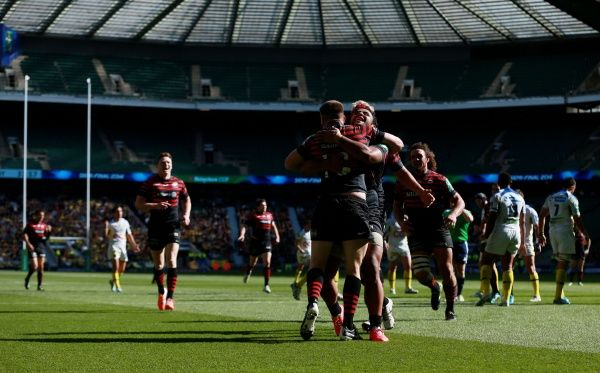 Saracens Owen Farrell is congratulated by Billy Vunipola and team mates after scoring their third try during the Heineken Cup Semi Final match at Twickenham, London