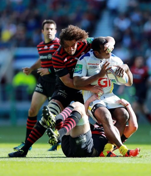 Clermont's Sitiveni Sivivatu is tackled by Saracens Jacques Burger during the Heineken Cup Semi Final match at Twickenham, London