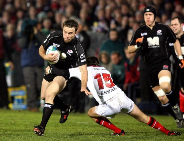 Saracens' Ben Russell (L) is stopped by Ulster's Bryn Cunningham during the Heineken Cup match at Ravenhill Park, Belfast, Friday December 9, 2005. PRESS ASSOCIATION Photo. Photo credit should read: Paul Faith/PA