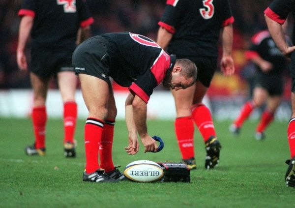 Saracens' Thierry Lacroix retrieves his kicking tee from the remote conrol car which took it out onto the field