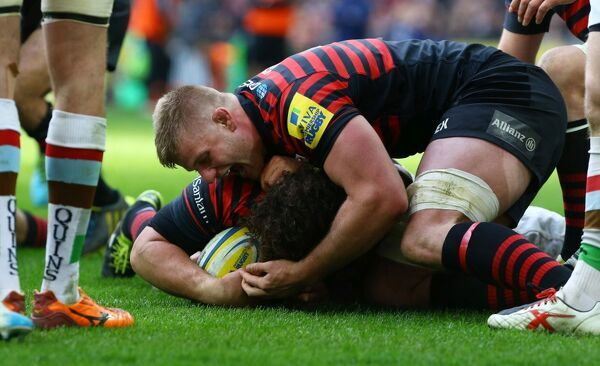 Saracens George Kruis (top) congratulates Jacques Burger after scoring try during the Aviva Premiership match at Wembley Stadium, London