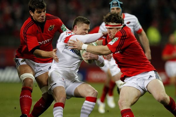 Munster's Donnacha O Callaghan and Mick Sherry tackling Saracen's Chris Ashton during the Heineken Cup Pool One match at Thomond Park, Limerick, Ireland