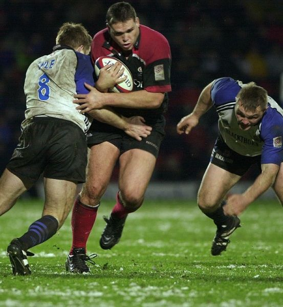 Bath's Dan Lyle, (left) holds up Saracen's Tony Diprose, while Bath's John Mallet (right) waits the outcome, during their Rugby Union match at Vicarage Road