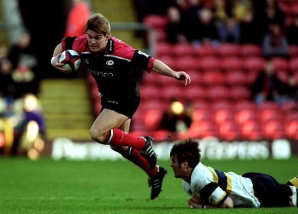 Saracens' new signing Tim Horan (l) skips out of a Worcester tackle as Saracens ease to victory