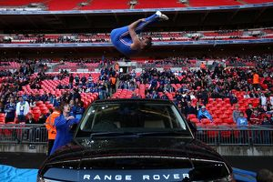 Acrobats entertain the crowd before kick off