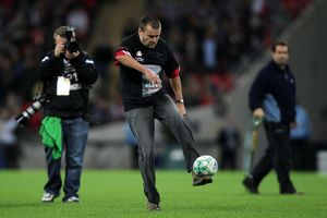A fan comepeting in 'Half-time Cross Bar Challenge'
