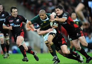 Saracens' Andy Saull (left) and Brad Barritt tackle South Africa's Juan de Jongh