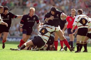 Saracens' Danny Grewcock is tackled by Wasps'Mark Weedon watched on by Saracens&#39