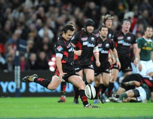 Saracens' Derick Hougaard kicks a drop goal to beat South Africa 24-23