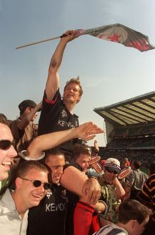 Saracens' Michael Lynagh is carried around Twickenham on the shoulders of his