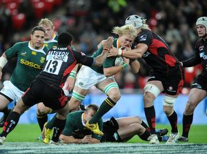 Saracens' Mouritz Botha tackles South Africa's Dewald Potgieter
