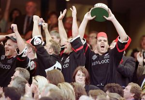 The Saracens team celebrate receiving the trophy
