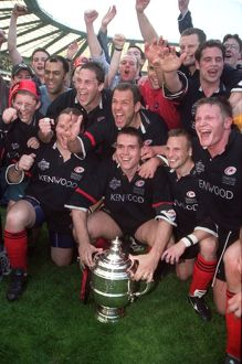 The Saracens team celebrate with the Tetley Cup